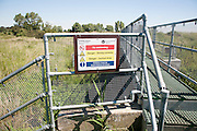 Drainage sluice sign, Fiveway Sluice, Oxley Marshes, Hollesley, Suffolk, England, UK
