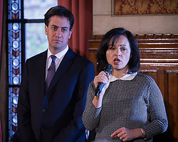 © Licensed to London News Pictures . 29/11/2013 . Manchester , UK . Ed Miliband listens as Shadow Energy Minister Caroline Flint MP addresses the audience . The leader of the Labour Party , Ed Miliband , addresses an audience at Manchester Town Hall today (Friday 29th November 2013) . The British opposition leader is launching a green paper on energy. Photo credit : Joel Goodman/LNP