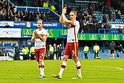 Match winning goal scorer Matthew Kilgallon (5) of Bradford City applauds the travelling fans as he celebrates the 1-0 win over Portsmouth at full time during the EFL Sky Bet League 1 match between Portsmouth and Bradford City at Fratton Park, Portsmouth, England on 28 October 2017. Photo by Graham Hunt.