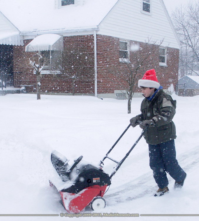 Alex Gambill, of Dayton, takes the snowblower from his father's driveway to a neighbors house.  The family helps several others when it snows.