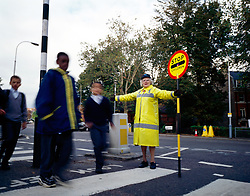 School crossing patrol outside school, UK