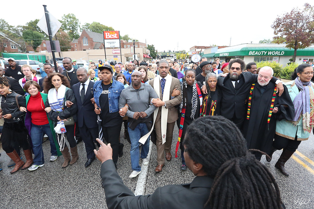 More than 300 clergy, faith leaders, and people of faith from across the United States march to the Ferguson Police Department as part of the Ferguson October Clergy March, to hold a memorial service for Mike Brown, and offering to receive the confessions of police officers and State Patrol while calling them to repent for being part of a racist system that has perpetrated violence against the community of Ferguson, Missouri.