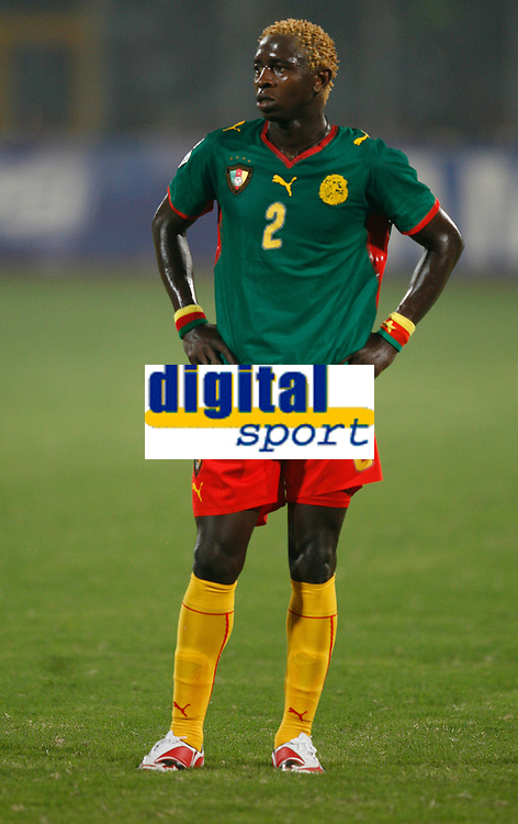Photo: Steve Bond/Richard Lane Photography.<br />Egypt v Cameroun. Africa Cup of Nations. 22/01/2008. Augustin Binya of Cameroon and Benfica contemplates defeat
