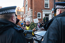 "Mayfair, London, November 28th 2014. A protest against Egypt's leader Al-Sisi descended into moinor scuffles as right wing ""patriots"" from anti-Islamic group Britain First arrived to protest against the presence of Islamist preacher Anjem Choudary, who was recently arrestred as part of an ant-terror operation. Playing patriotic British Music, Britain First accused Muslims of worshiping a ""devil"" and a ""paedophile prophet"". Police had to intervene before hotheads on both sides became violent. PICTURED: Police block the path of an anti-Sisi protester as he tries to reach the door of the Egyptian embassy."