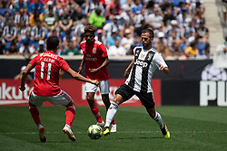 July 28, 2018 - Harrison, New Jersey, United States - Juventus midfielder MIRALEM PJANIĆ (5) dribbles the ball against SL Benfica midfielder FRANCO CERVI (11) during the International Champions Cup at Red Bull Arena in Harrison, NJ.  Juventes vs Benfica (Credit Image: © Mark Smith via ZUMA Wire)