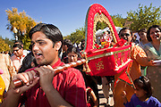Nov. 22, 2009 -- PHOENIX, AZ: Men carry Ganesha, an Indian Hindu deity, through the streets during the annual Discover India Festival in Phoenix, AZ. This is the 8th year the Indian Association of Phoenix has sponsored the festival, which started as a celebration of Diwali, the Indian Festival of Lights, and has since grown to be a celebration of India's cultures, traditions and diversity.    Photo by Jack Kurtz