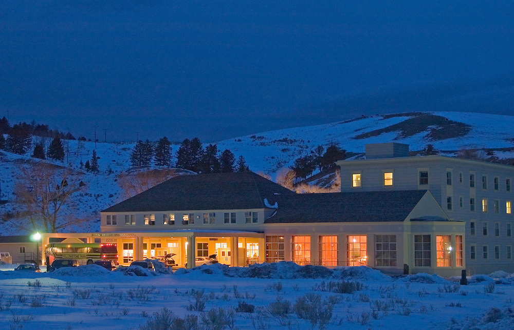 Mammoth Hot Springs Hotel at dusk in winter; a historic lodge at the northwest entrance to Yellowstone National Park, Wyoming. #D0401808