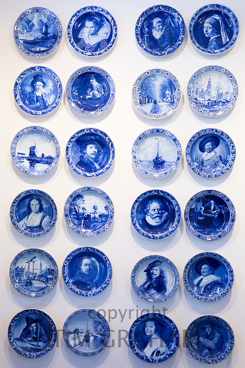 Delft Blue luxury old hand-painted porcelain commemorative plates  at Royal Delft Experience shop in Amsterdam, Holland