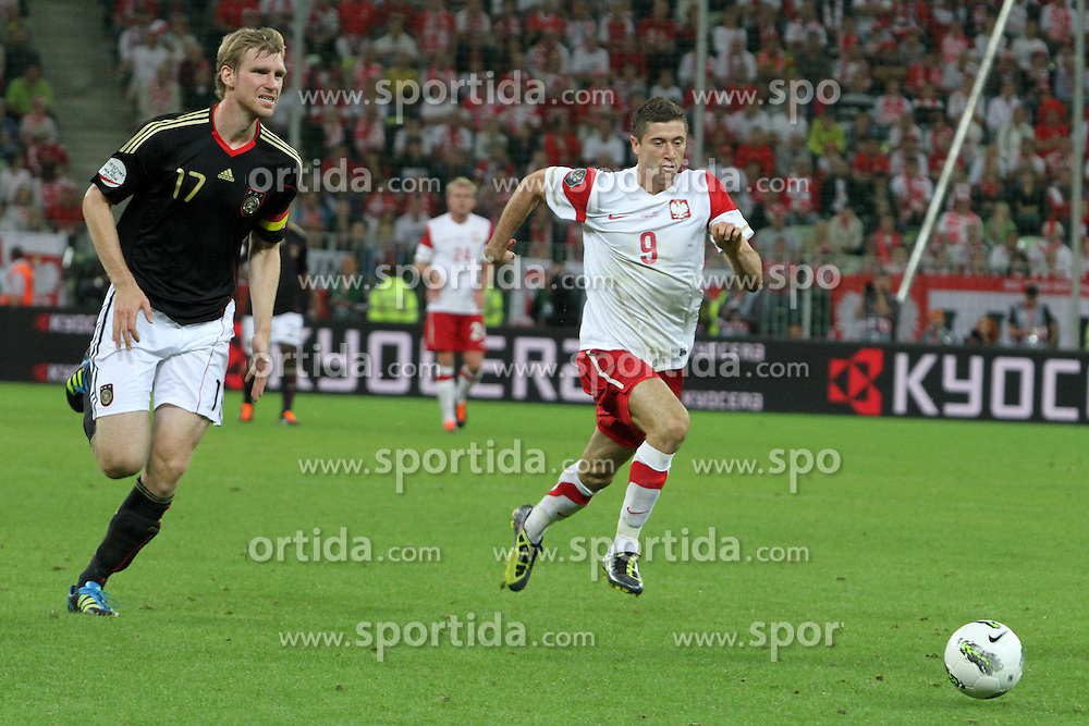 06.09.2011, PGE Arena, Danzig, POL, FSP, Polen vs Deutschland, im Bild PER MERTESACKER ROBERT LEWANDOWSKI// during the international frindly football game between Poland and Germany at PGE Arena Gdansk Poland on 2011-09-06. EXPA Pictures © 2011, PhotoCredit: EXPA/ Newspix/ Maciej Opala +++++ ATTENTION - FOR AUSTRIA/(AUT), SLOVENIA/(SLO), SERBIA/(SRB), CROATIA/(CRO), SWISS/(SUI) and SWEDEN/(SWE) CLIENT ONLY +++++