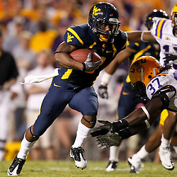 Sep 25, 2010; Baton Rouge, LA, USA; West Virginia Mountaineers wide receiver Jock Sanders (9) runs past LSU Tigers safety Karnell Hatcher (37) for a touchdown during the second half at Tiger Stadium. LSU defeated West Virginia 20-14.  Mandatory Credit: Derick E. Hingle