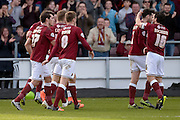 Cobblers celebrate Northampton Town Striker John Marquis opening goal during the Sky Bet League 2 match between Northampton Town and Newport County at Sixfields Stadium, Northampton, England on 25 March 2016. Photo by Dennis Goodwin.