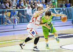 Beka Tsivtsivadze of Georgia vs Jaka Klobucar of Slovenia during friendly basketball match between National teams of Slovenia and Georgia in day 2 of Adecco Cup 2014, on July 25, 2014 in Dvorana OS 1, Murska Sobota, Slovenia. Photo by Vid Ponikvar / Sportida.com