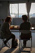 Fumiko Iwama, 74 years old and Yooko Takahashi, 60 years old  at a temporay housing where they live. Ishinomaki, Japan.
