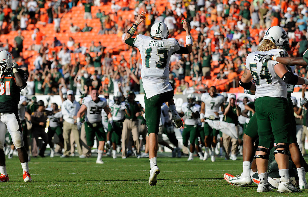 MIAMI GARDENS, FL - NOVEMBER 27: Bobby Eveld #13 of the South Florida Bulls reacts after the Bulls scored the game winning touchdown in overtime during the game against the Miami Hurricanes at Sun Life Stadium in Miami Gardens, Florida on November 27, 2010. South Florida defeated the Hurricanes 23-20.