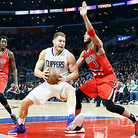 12 December 2016: Portland Trail Blazers guard Evan Turner (1) defends on LA Clippers forward Blake Griffin (32) during the LA Clippers 121-120 victory over the Portland Trail Blazers, at the Staples Center, Los Angeles, California, USA.