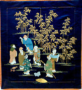 Gift cover.  Dark blue satin weave silk with embroidery.  The Seven Sages represent a group of third century Chinese scholars who met in a bamboo grove to relax, drink and discuss Taoist philosophy.  In Japan they are popularly equated with the Seven Gods of Good Fortune.