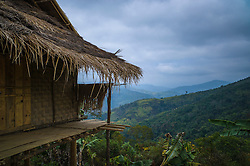 Traditional dwelling set on the hillside of Phou Lao Village located between Roads 6 and 1C in Houaphanh Province, Laos, Southeast Asia