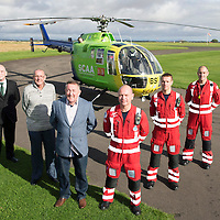 National Air Ambulance Week.. Britain's last Bolkow helicopter air ambulance operated by SCAA prepares to fly into history when it is replaced by EC-135 in November 2015. To mark this Scotland's original Bolkow paramedics gathered at Perth Airport to meet the current crew.<br /> Pictured from left to right Gerry Kelly, Robert Devine, Ian Golding who served as Paramedics on the Bolkow when first introduced to Scotland in 1989, current Paramedics John Salmond, Mark Tynan and Lead Paramedic John Pritchard<br /> Picture by Graeme Hart.<br /> Copyright Perthshire Picture Agency<br /> Tel: 01738 623350  Mobile: 07990 594431