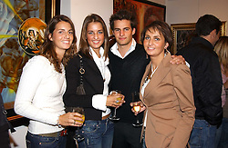 Left to right, MARINE STERNICK, TIPHANIE STERNICK, DEREK STERNICK and KRISTELL STERNICK at the opening of the Opera Gallery in London, 134 New Bond Street, London W1 on 29th September 2005.<br />