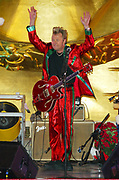 NEW YORK - DECEMBER 4: Brian Setzer Orchestra performs at the 70th Annual Rockefeller Center Chrismas Tree Lighting December 4, 2002 in New York City.   (Photo by Matthew Peyton)