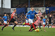 Portsmouth Midfielder, Ronan Curtis (11) gets past Sunderland Defender, Jack Baldwin (15) during the EFL Sky Bet League 1 match between Portsmouth and Sunderland at Fratton Park, Portsmouth, England on 22 December 2018.