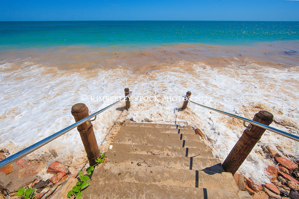 Waves cover the steps to the beach on a super high tide at Cable Beach.