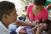 A health worker vaccinates a child against rotavirus during a vaccination session at the primary school in the town of Coyolito, Honduras on Wednesday April 24, 2013.