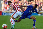 Leicester City's Riyad Mahrez and Stoke City's Erik Pieters tussle for the ball during the Barclays Premier League match between Stoke City and Leicester City at the Britannia Stadium, Stoke-on-Trent, England on 19 September 2015. Photo by Aaron Lupton.
