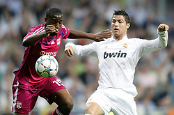 18.10.2011, Santiago Bernabeu Stadion, Madrid, ESP, UEFA CL, Gruppe D, Real Madrid (ESP) vs Olympique Lyon (FRA), im Bild Real Madrid's Cristiano Ronaldo against Olympique Lyonnnais' Gueida Fofana during UEFA Champions League match // during UEFA Champions League group D match between Real Madrid (ESP) and Olympique Lyon (FRA) at City of Santiago Bernabeu Stadium, Madrid, Spain on 18/10/2011. EXPA Pictures © 2011, PhotoCredit: EXPA/ Alterphoto/ Alvaro Hernandez +++++ ATTENTION - OUT OF SPAIN/(ESP) +++++