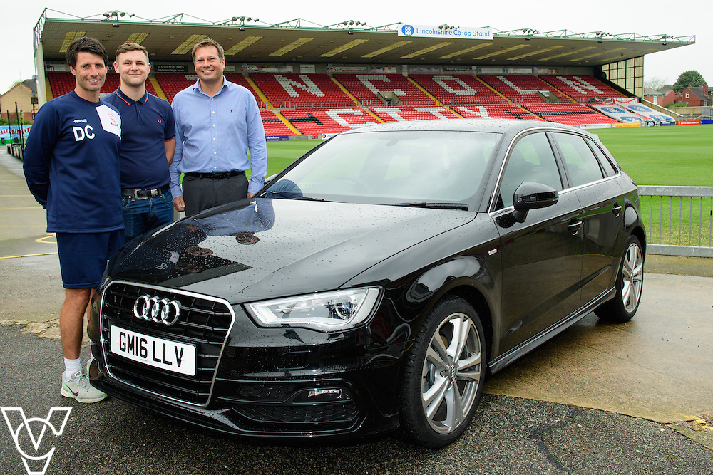 Lincoln City manager Danny Cowley has been presented with a new Audi A3 car thanks to sponsorship from Just Vehicle Solutions and Argentum Finance.  Pictured, from left, Danny Cowley (Lincoln City manager), Jake Matthews (Just Vehicle Solutions), Mike Wells (Argentum Finance).<br /> <br /> Picture: Chris Vaughan/Chris Vaughan Photography<br /> Date: August 19, 2016