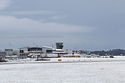 © Licensed to London News Pictures. 02/03/2016. Leeds, UK. A blanket of snow covers the ground at Leeds Bradford Airport after heavy snow fall in Yorkshire this morning. Many flights have been delayed whilst ground teams clear the snow. Forecaster are predicting more snowfall and strong winds as Storm Jake moves in. Photo credit : Ian Hinchliffe/LNP