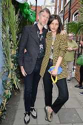 JEFFERSON HACK and TATI COTLIAR at the launch of the new collection from Limoland held at Anderson & Sheppard's Haberdashery, 17 Clifford Street,London on 16th June 2014.