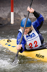 Joey Yeaple of Ballwin, Missouri races in the K1 women's long plastic class during the slalom course of the 42nd Annual Missouri Whitewater Championships. Yeaple placed first place in the class. The Missouri Whitewater Championships, held on the St. Francis River at the Millstream Gardens Conservation Area, is the oldest regional slalom race in the United States.