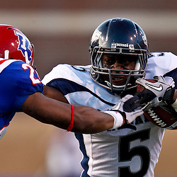 December 4, 2010; Ruston, LA, USA; Nevada Wolf Pack running back Mike Ball (5) stiff arms Louisiana Tech Bulldogs cornerback Terry Carter (28) during the second half at Joe Aillet Stadium.  Nevada defeated Louisiana Tech 35-17. Mandatory Credit: Derick E. Hingle