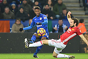 Leicester City midfielder Demarai Gray (22) crosses the ball with Manchester United defender Daley Blind (17) making a tackle during the Premier League match between Leicester City and Manchester United at the King Power Stadium, Leicester, England on 5 February 2017. Photo by Jon Hobley.