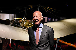 "© Licensed to London News Pictures. 23/05/2017. London, UK.   Norman Foster stands in front of a replica Santos-Dumont 20 aeroplane at the press preview of ""Cartier in Motion"", an exhibition on Cartier, co-curated by celebrated architect Lord Norman Foster and Design Museum director Deyan Sudjic, at the Design Museum in London.  The exhibition runs from 25 May to 28 July 2017. Photo credit : Stephen Chung/LNP"