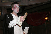 Actor during a play about English medieval Courts in one of the rooms inside the London Dungeon, England, on Thursday, Oct. 12, 2006. The London Dungeon is a live theatre attraction where visitors are taken by the actors through different areas featuring the darkest parts of British history. Some of the more than 40 exhibits include 'The Great Fire of London', 'Jack the Ripper', 'Judgement Day', 'The Torture Chamber', 'Henry VIII', 'The Tower of London' and 'The French Revolution'. In 2003 a new part opened focused on the Great Plague of 1665.   **Italy Out**..