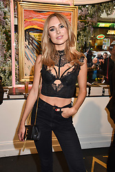 Kimberley Garner at a private view of work by Bradley Theodore entitled 'The Second Coming' at the Maddox Gallery, 9 Maddox Street, London England. 19 April 2017.