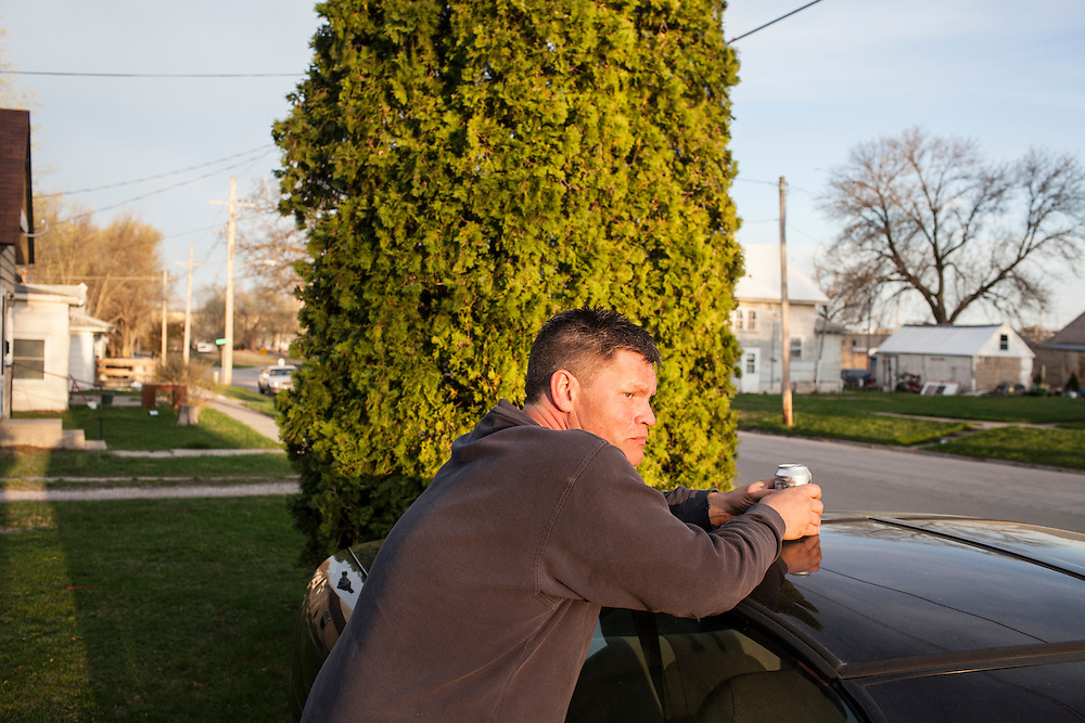 Steve McFarland leans on his Camaro and drinks a beer in his front yard on Friday, March 23, 2012 in Webster City, IA.