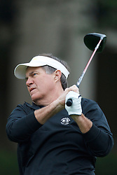 Feb 12, 2012; Pebble Beach CA, USA; New England Patriots head coach Bill Belichick hits his tee shot on the first hole during the final round of the AT&T Pebble Beach Pro-Am at Pebble Beach Golf Links. Mandatory Credit: Jason O. Watson-US PRESSWIRE