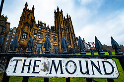 Detail of street sign on The Mound with Edinburgh University new College to rear, Edinburgh, Scotland, United Kingdom