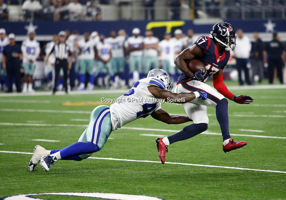 Houston Texans wide receiver Uzoma Nwachukwu (17) gets tackled by Dallas Cowboys rookie linebacker Donnie Baggs (46) as he catches a fourth quarter pass for a gain of 15 yards and a first down during the 2015 NFL preseason football game against the Dallas Cowboys on Thursday, Sept. 3, 2015 in Arlington, Texas. The Cowboys won the game 21-14. (©Paul Anthony Spinelli)