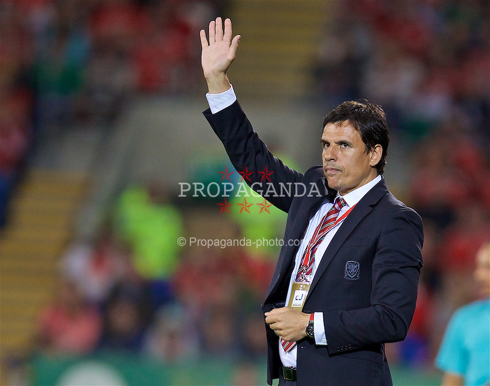 CARDIFF, WALES - Monday, September 5, 2016: Wales' manager Chris Coleman waves to the supporters as his team beat Moldova 4-0 during the 2018 FIFA World Cup Qualifying Group D match at the Cardiff City Stadium. (Pic by David Rawcliffe/Propaganda)