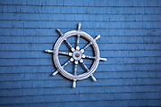 Painted cedar shingle with ships wheel in Newport, Rhode Island, USA