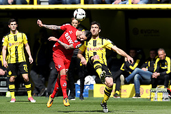 DORTMUND, April 30, 2017  Sokratis Papastathopoulos(R) of Borussia Dortmund vies with Leonardo Bittencourt of 1.FC Cologne during the Bundesliga soccer match between Borussia Dortmund and 1.FC Cologne at the Signal Iduna Park in Dortmund, Germany on April 29, 2017. The match ended in a 0-0 draw. (Credit Image: © Joachim Bywaletz/Xinhua via ZUMA Wire)