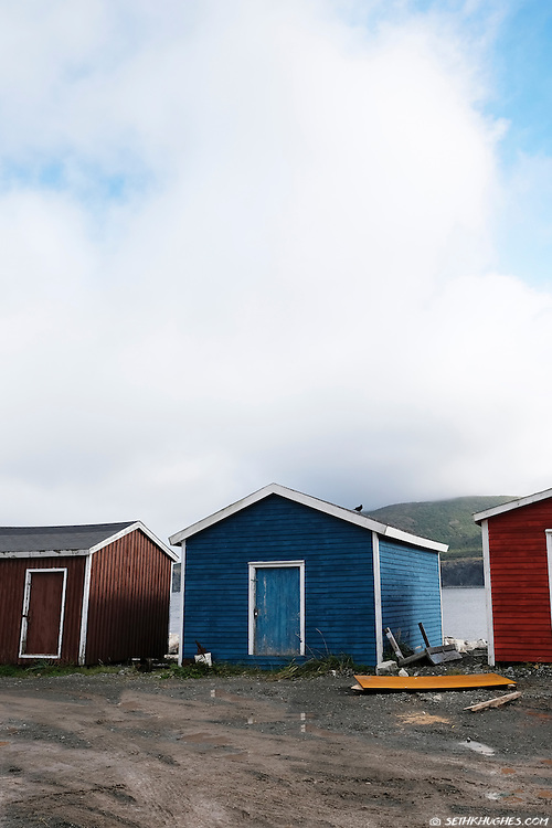 Colorful sheds in the rural fishing town of Trout River, Gros Morne National Park, Canada