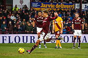 Hearts FC Forward Gavin Reilly scoring the penalty during the Ladbrokes Scottish Premiership match between Heart of Midlothian and Motherwell at Tynecastle Stadium, Gorgie, Scotland on 16 January 2016. Photo by Craig McAllister.
