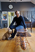 Philip Watts in the showroom of his design studio, on the caterpillar bench in Nottingham, UK. CREDIT: Vanessa Berberian for The Wall Street Journal<br /> GURU-WATTS