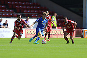 AFC Wimbledon midfielder Jake Reeves (8) skips past Walsall FC midfielder Erhun Oztumer (10) and Walsall FC midfielder Florent Cuvelier (8)  during the EFL Sky Bet League 1 match between Walsall and AFC Wimbledon at the Banks's Stadium, Walsall, England on 6 August 2016. Photo by Stuart Butcher.