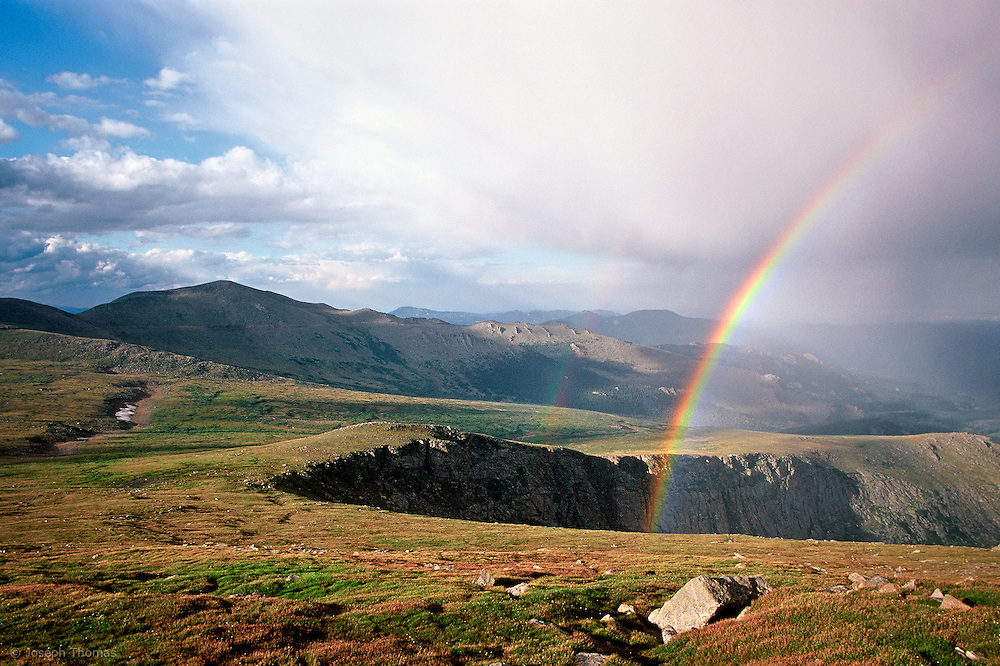 A clearing storm leaves a double rainbow in its wake. Mount Evans Wilderness.